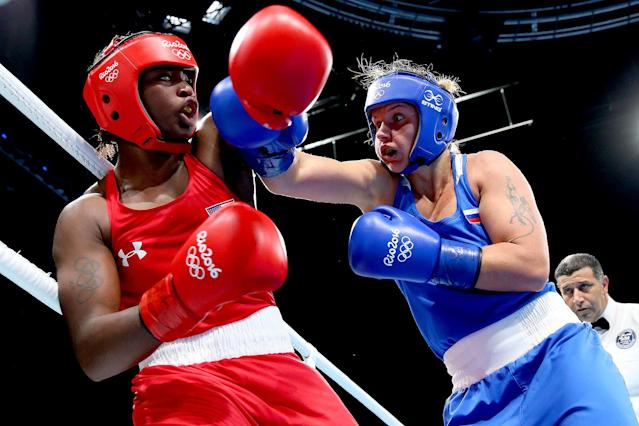 <p>Claressa Maria Shields of the United States and Iaroslava Iakushina of Russia exchange blows during the Women's Middleweight Quarterfinal on Day 12 of the Rio 2016 Olympic Games at Riocentro – Pavilion 6 on August 17, 2016 in Rio de Janeiro, Brazil. (Photo by Alex Livesey/Getty Images) </p>