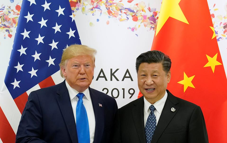 U.S. President Donald Trump and China's President Xi Jinping poses for a photo ahead of their bilateral meeting during the G20 leaders summit in Osaka, Japan, June 29, 2019. REUTERS/Kevin Lamarque