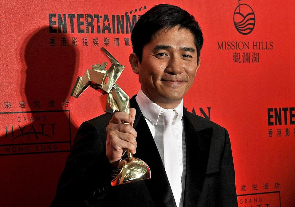 HONG KONG - MARCH 17: Chinese actor Tony Leung Chiu-wai wins Best Actor for 'Lust, Caution' at the Asian Film Awards 2008 in Hong Kong, China (Photo by Andrew Ross/Getty Images)