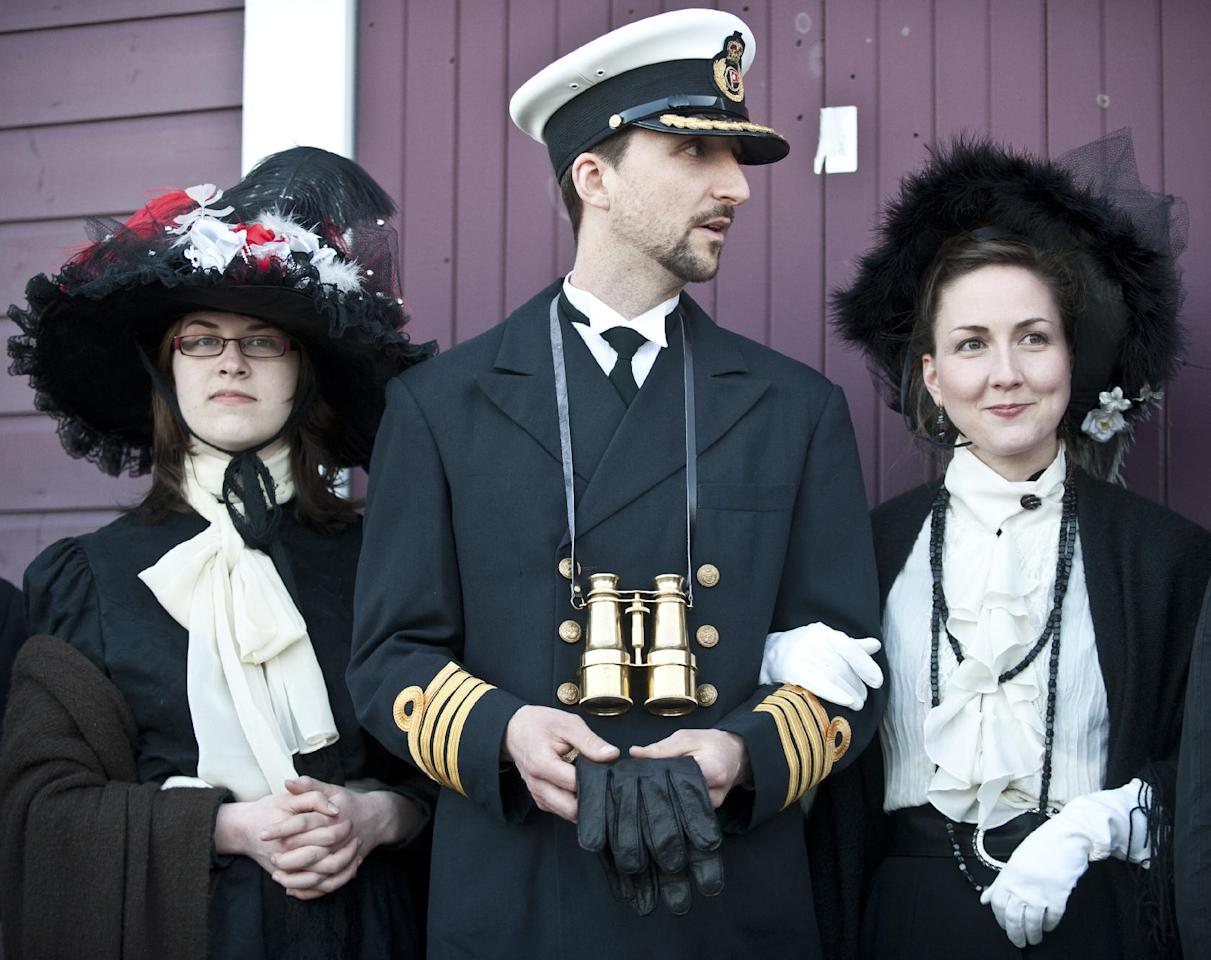 People gather in Halifax, Nova Scotia, to mark the centenary of the sinking of the Titanic with a torchlight procession, and musical performances. (AFP Photo/Rogerio Barbosa)