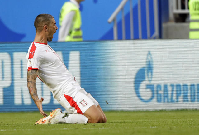 Serbia's Aleksandar Kolarov celebrates scoring the opening goal during the group E match between Costa Rica and Serbia at the 2018 soccer World Cup in the Samara Arena in Samara, Russia, Sunday, June 17, 2018. (AP Photo/Mark Baker)