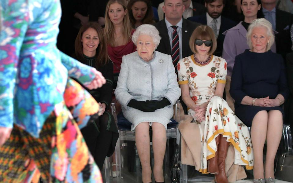 The Queen, Anna Wintour and Angela Kelly at London Fashion Week in 2018 - AFP
