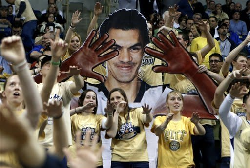 Pittsburgh fans cheer near a sign in the likeness of player Steven Adams, from New Zealand, during the first half of an NCAA college basketball game against Notre Dame on Monday, Feb. 18, 2013 in Pittsburgh. (AP Photo/Keith Srakocic)