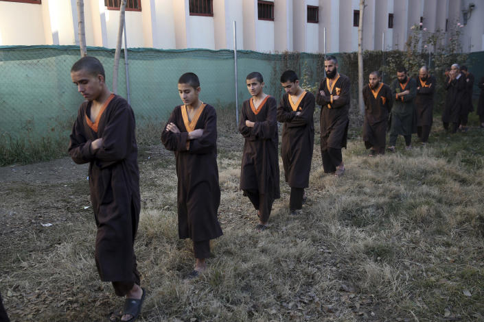 Islamic State militants either arrested or surrounded up to the Afghan government are presented to media in Kabul, Afghanistan, Saturday, Dec. 21, 2019. The country's intelligence service says Saturday that there are more than 75 women and 159 children most of them form foreign countries in the custody of the agency known as the National Deteriorate for Security. (AP Photo/Rahmat Gul)