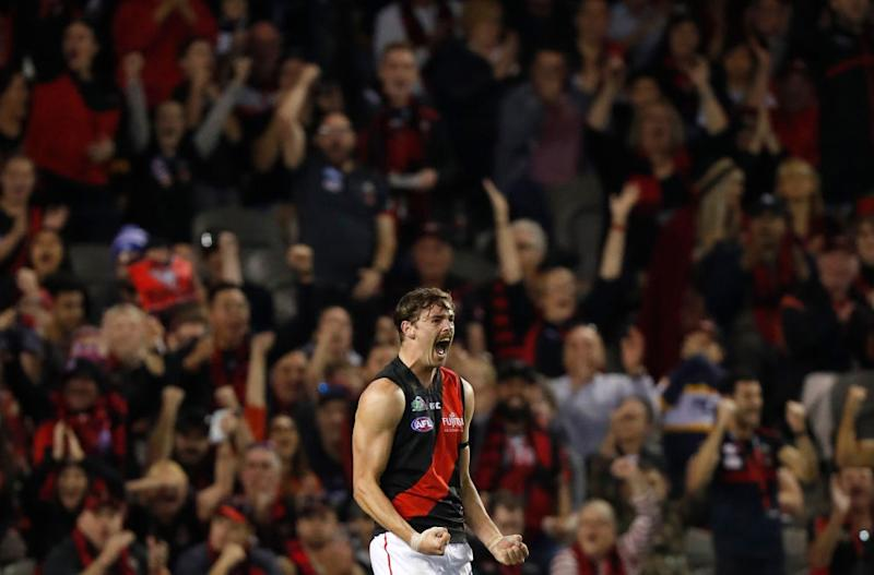 Joe Daniher of the Bombers celebrates a goal during the 2019 AFL round 05 match between the North Melbourne Kangaroos and the Essendon Bombers at Marvel Stadium on April 19, 2019 in Melbourne, Australia. (Photo by Michael Willson/AFL Photos)