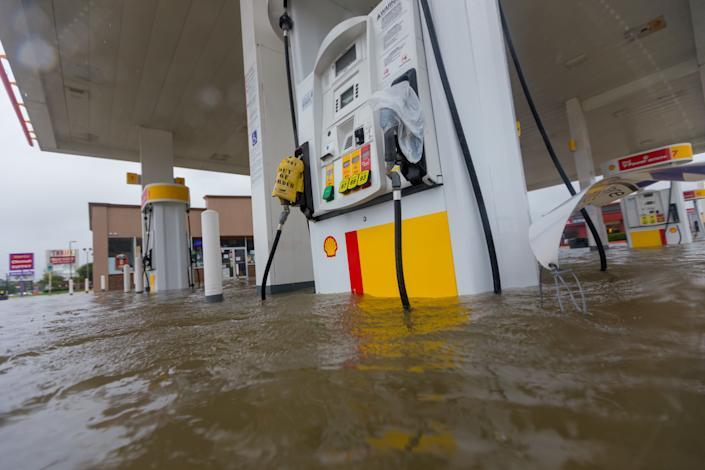 A Shell gas station is underwater at the intersection of Wallisville and Uvalde in Houston.