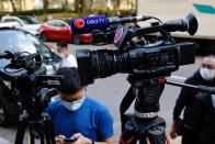 The logo of Cable TV news is seen on a camera outside its building after about 100 members of staff have been laid off in Hong Kong