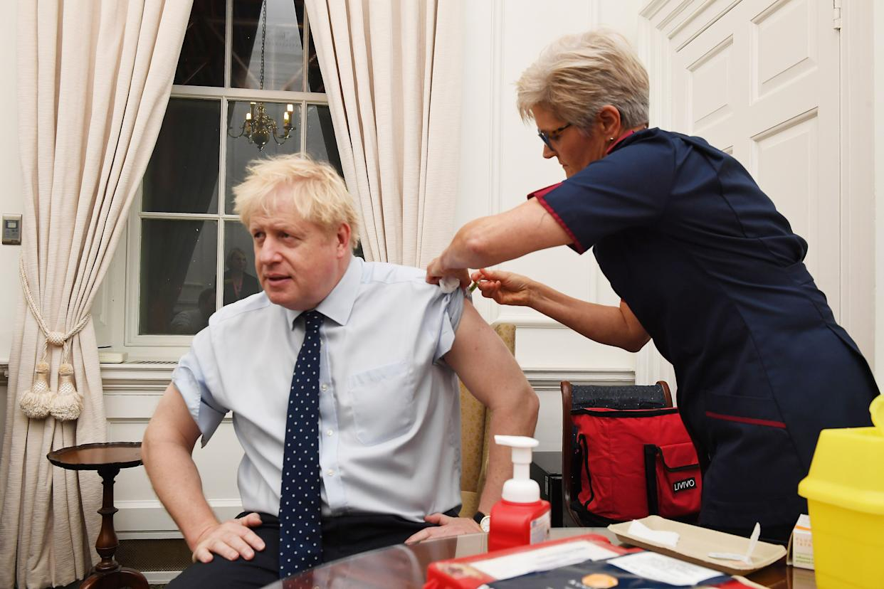 Boris Johnson receiving a flu vaccine in October last year. One of his top coronavirus advisers has said the prime minister shouldn't be first to receive a COVID-19 vaccine. (Jeremy Selwyn/pool/AFP via Getty Images)      Picture Jeremy Selwyn  Evening Standard (Photo by Jeremy Selwyn / POOL / AFP) (Photo by JEREMY SELWYN/POOL/AFP via Getty Images)