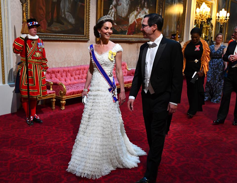 The Duchess of Cambridge wore Princess Diana's Lover's Knot tiara and the Queen Mother's sapphire and diamond fringe earrings with a bespoke Alexander McQueen gown for the US State Banquet in June 2019. Kate also donned her Royal Family Order, on her left shoulder, and debuted her Royal Victorian Order, which she was awarded by the Queen in April in recognition of her services to the crown (PA)