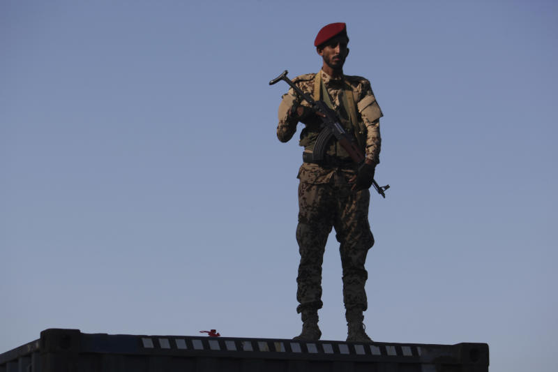 In this Wednesday, Dec. 12, 2018 photo, a soldier allied to Yemen's internationally recognized government stands guard at the port of Aden in Aden, Yemen. A sense of normalcy has returned to Aden, now the seat of power for Yemen's internationally recognized government, but many challenges remain for bringing a lasting peace to the Arab world's poorest country. (AP Photo/Jon Gambrell)