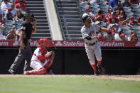 Boston Red Sox's Xander Bogaerts, right, hits a two-run home run as Los Angeles Angels catcher Max Stassi, center, watches along with home plate umpire Jeremie Rehak during the third inning of a baseball game Sunday, Sept. 1, 2019, in Anaheim, Calif. (AP Photo/Mark J. Terrill)