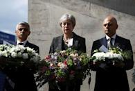 Britain's Prime Minister Theresa May, London's Mayor Sadiq Khan and Home Secretary Sajid Javid hold wreaths during commemorations of the first anniversary of the attack on London Bridge, in London, Britain, June 3, 2017. REUTERS/Simon Dawson