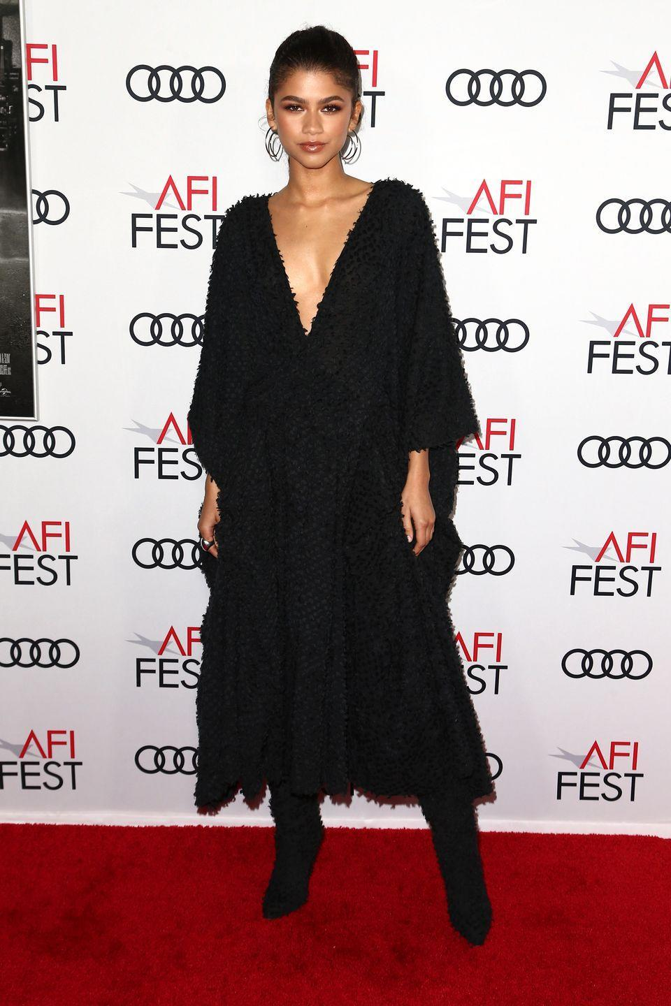 <p>Zendaya wore a dress and boots by Imane Ayissi and Kendra Scot earrings for the <em>Queen and Slim</em> premiere in Hollywood. <br></p>