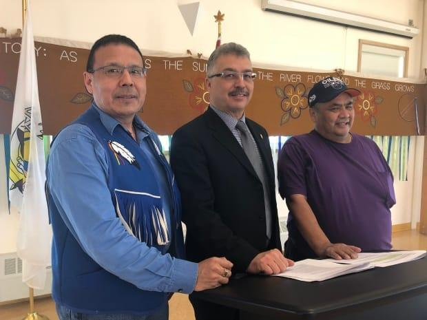 Ndilo Chief Ernest Betsina, left, N.W.T. MP Michael McLeod, and Dettah Chief Eddie Sangris in a file photo from 2018. The Yellowknives Dene First Nation will get $18.8 million for new affordable housing in Ndilo and Dettah, N.W.T. (Gabriela Panza-Beltrandi - image credit)