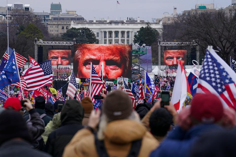 In this Jan. 6, 2021 file photo, Trump supporters participate in a rally in Washington.