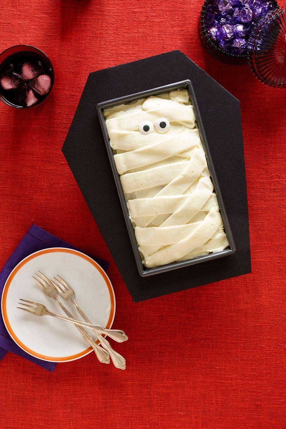 """<p>Thick bands of cream cheese frosting give this pumpkin loaf cake a mummified look.</p><p><a href=""""https://www.womansday.com/food-recipes/food-drinks/recipes/a60153/coffin-cake-recipe/"""" rel=""""nofollow noopener"""" target=""""_blank"""" data-ylk=""""slk:Get the recipe from Woman's Day »"""" class=""""link rapid-noclick-resp""""><em>Get the recipe from Woman's Day »</em></a> </p>"""
