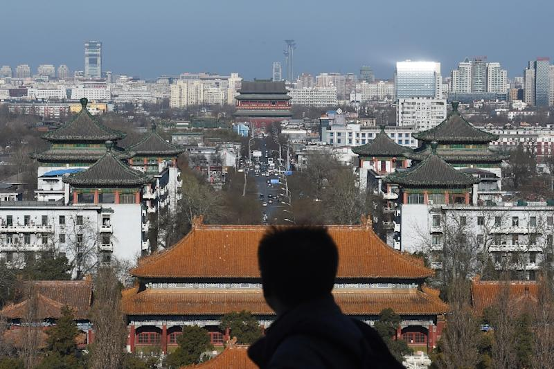 Despite decades of development, the centre of Beijing still has pockets of ancient courtyard homes with traditional roofs, packed along narrow alleys (AFP Photo/Greg Baker)