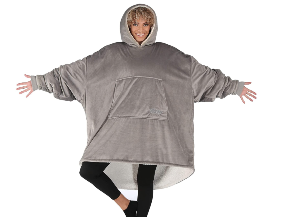 woman wearing grey Hooded blanket from the comfy on sale for Prime Day