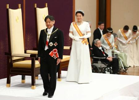 Japan's Emperor Naruhito and Empress Masako leave a ceremony called Sokui-go-Choken-no-gi, his first audience after the accession to the throne , at the Imperial Palace in Tokyo, May 1, 2019.  Japan Pool/Pool via REUTERS