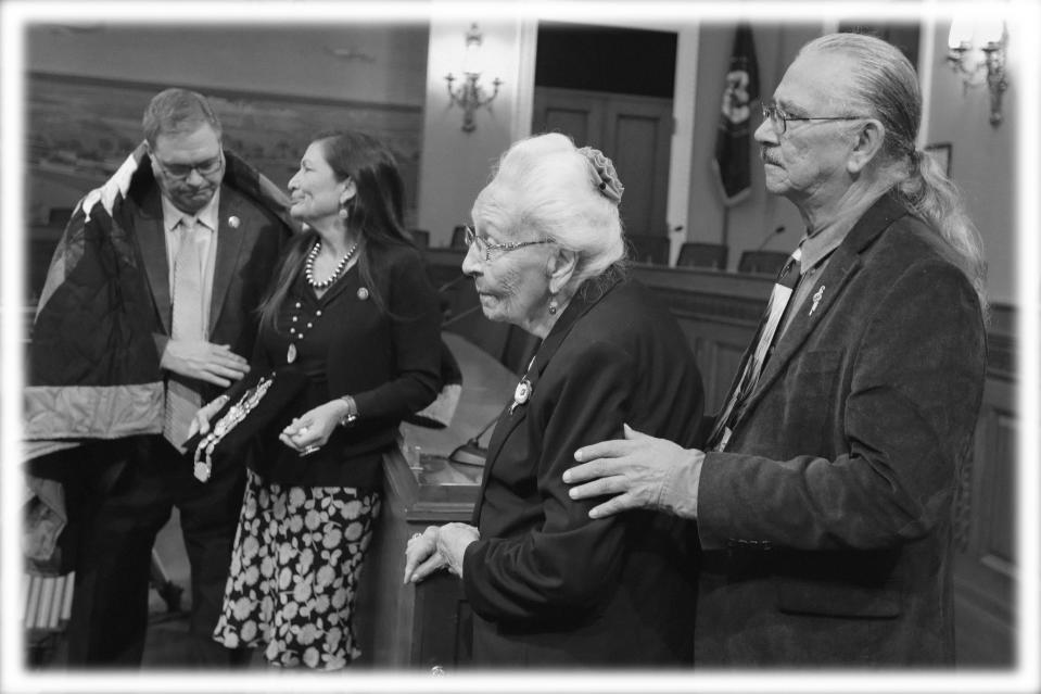 Four Directions co-founder O.J. Semans, right, and Marcella LeBeau, whose ancestor died at Wounded Knee, watch during a news conference Tuesday, June 25, 2019, on Capitol Hill in Washington. At left Rep. Paul Cook, R-Calif., talks with Rep. Deb Haaland, D-N.M. Advocates for Native Americans called for Congress to revoke the Medals of Honor given to the U.S. soldiers who participated in the Wounded Knee massacre. (Photo: Kali Robinson/AP; digitally enhanced by Yahoo News)