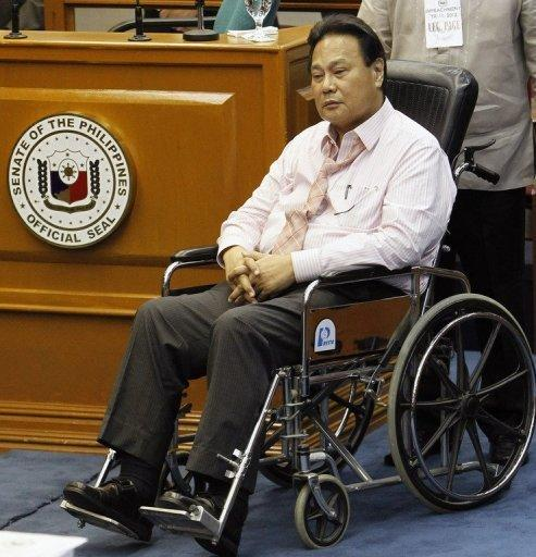 Philippines Chief Justice Renato Corona at his impeachment trial in a wheelchair on May 22. The Philippines' top judge was later rushed to hospital after suffering an apparent heart attack, his spokesman said Wednesday