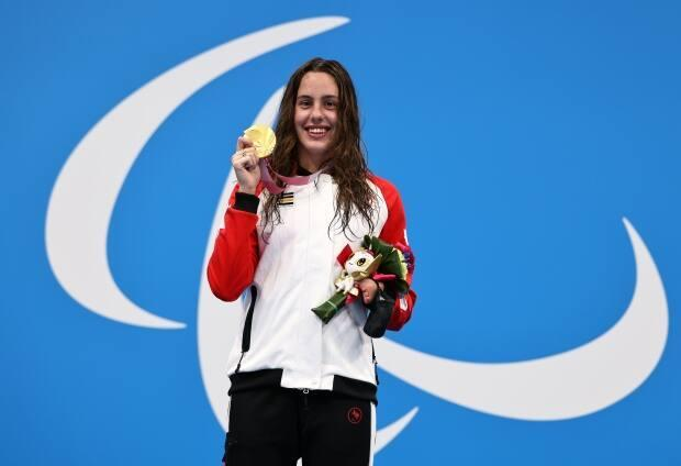 Canada's Aurélie Rivard poses with her S10 100-metre freestyle gold medal, one of two titles and five podium appearances for her at the Tokyo Paralympics. (Buda Mendes/Getty Images - image credit)