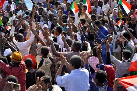 Sudanese demonstrators celebrate after Defence Minister Awad Ibn Auf stepped down as head of the country's transitional ruling military council, as protesters demanded quicker political change, near the Defence Ministry in Khartoum, Sudan April 13, 2019. REUTERS/Stringer