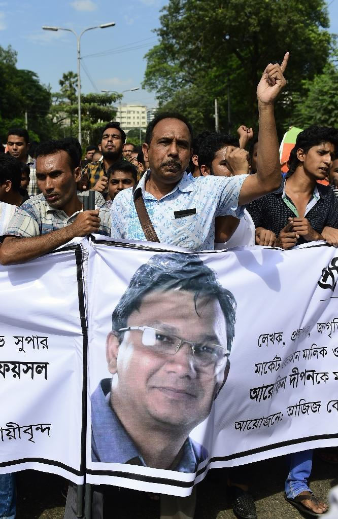 Bangladeshi activists holding a banner with a photo of publisher Faisal Arefin Dipan, a secular publisher muredered by suspected Islamists, take part in a protest in Dhaka on November 1, 2015 (AFP Photo/Munir Uz Zaman)