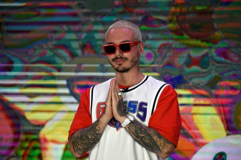 """J Balvin, shown here in Mexico City for the 2020 launch of his album """"Colors,"""" is among the global forces of reggaeton, a massively popular genre"""