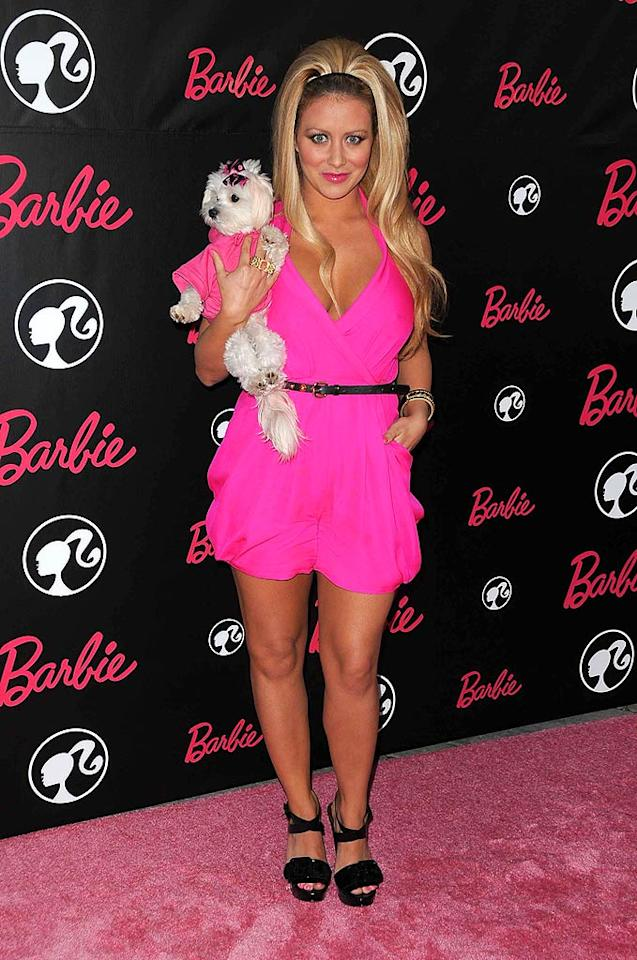"""Hopefully, Ginger is looking for an escape route. The mini Maltese shouldn't have to share the pink carpet with her overly tanned owner, former Danity Kane darling Aubrey O'Day. Entertainment Press/<a href=""""http://www.splashnewsonline.com/"""" target=""""new"""">Splash News</a> - March 9, 2009"""
