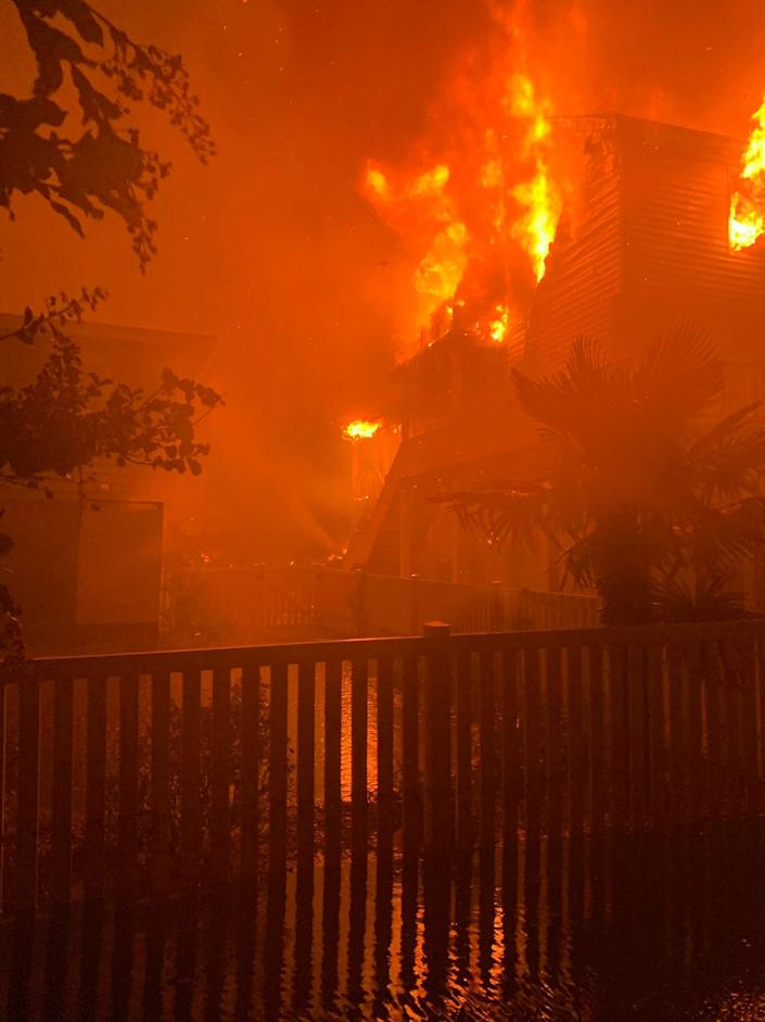 Multiple structure fires burn on August 4, 2020, in Ocean Isle Beach, North Carolina after Hurricane Isaias made landfall.