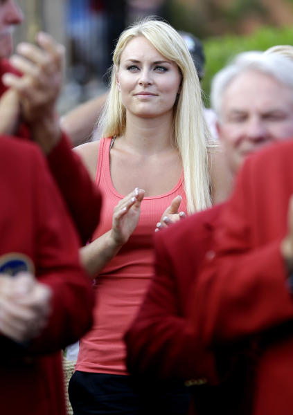Skier Lindsey Vonn applauds as her boyfriend Tiger Woods receives the trophy after winning The Players Championship golf tournament at TPC Sawgrass, Sunday, May 12, 2013, in Ponte Vedra Beach, Fla. (AP Photo/John Raoux)