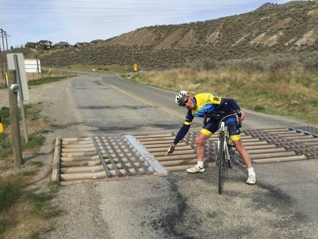 Mike Stewart-Smith, director of Interior Grasslands Cycling Club, says the metal strips make a huge difference for cyclists' safety along rural roads. (Jenifer Norwell/CBC - image credit)