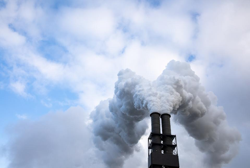 04 November 2019, Hamburg: Exhaust air rises from the chimneys of the Moorburg coal-fired power plant into the sky. The Vattenfall energy group operates one of the largest and most modern coal-fired power plants in Europe in Hamburg-Moorburg. Photo: Christian Charisius/dpa (Photo by Christian Charisius/picture alliance via Getty Images)