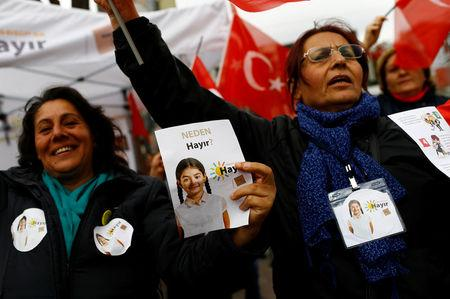 "FILE PHOTO: ""Hayir"", ""No"" in English, supporters hold Turkish flags and leaflets for the upcoming referendum at a campaign point in Istanbul, Turkey, March 31, 2017. REUTERS/Murad Sezer/File Photo"