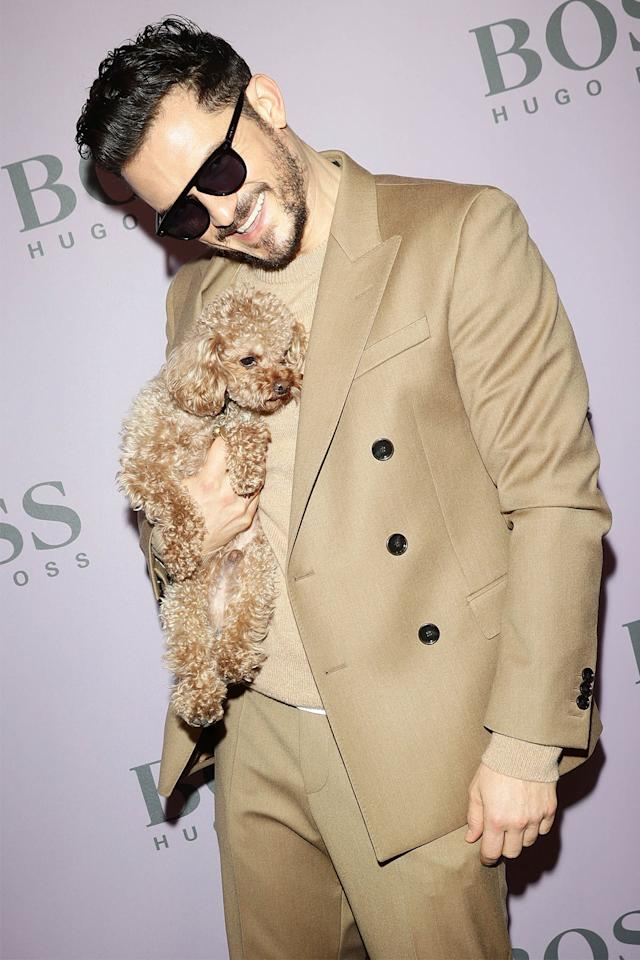 <p>Orlando Bloom adorably matches with his puppy at the BOSS fashion show in Milan, Italy, on Sunday.</p>