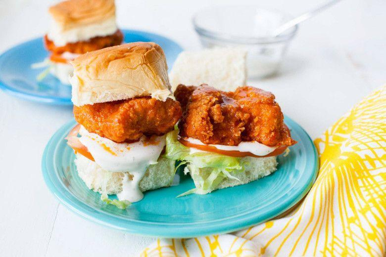 """<p>Hawaiian sweet rolls are the key to these delicious sliders. </p><p><strong><a href=""""https://thepioneerwoman.com/food-and-friends/buffalo-chicken-sliders/"""" rel=""""nofollow noopener"""" target=""""_blank"""" data-ylk=""""slk:Get the recipe"""" class=""""link rapid-noclick-resp"""">Get the recipe</a>. </strong></p><p><strong><a class=""""link rapid-noclick-resp"""" href=""""https://go.redirectingat.com?id=74968X1596630&url=https%3A%2F%2Fwww.walmart.com%2Fip%2FThe-Pioneer-Woman-Vintage-Floral-4-Piece-Dinner-Plate-Set%2F55467844&sref=https%3A%2F%2Fwww.thepioneerwoman.com%2Ffood-cooking%2Fmeals-menus%2Fg32157273%2Ffourth-of-july-appetizers%2F"""" rel=""""nofollow noopener"""" target=""""_blank"""" data-ylk=""""slk:SHOP PLATES"""">SHOP PLATES</a><br></strong></p>"""