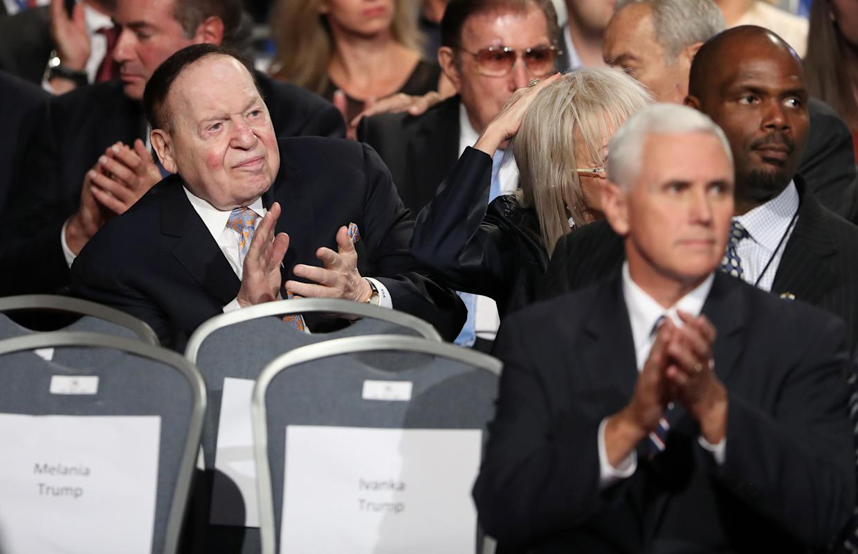 Businessman Sheldon Adelson (L) and Republican candidate for Vice President Mike Penceapplaude before the first presidential debate at Hofstra University in Hempstead, New York on September 26, 2016. Hillary Clinton and Donald Trump face off in one of the most consequential presidential debates in modern US history with up to 100 million viewers set to tune in. / AFP / POOL / joe raedle        (Photo credit should read JOE RAEDLE/AFP/Getty Images)