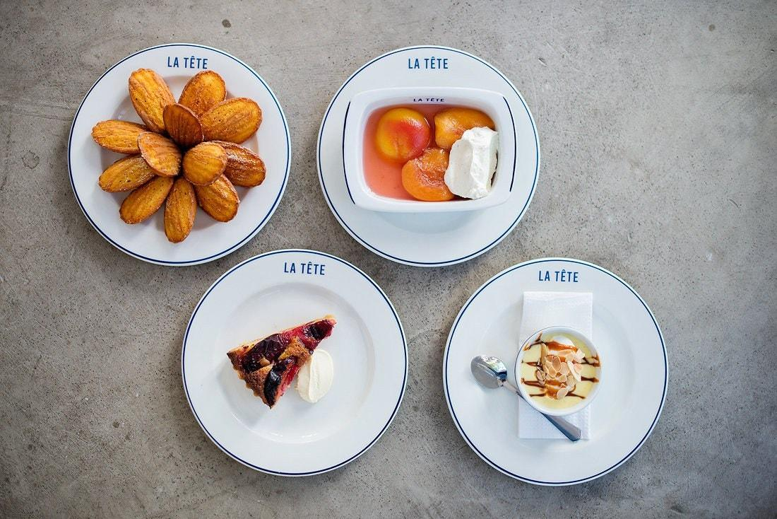 """<p><strong>What's the vibe, inside and out?</strong><br> A buzzing, sociable restaurant in a 1930s art-deco building at the Foreshore end of Bree Street. From the pass of the open kitchen, chef-patron Giles Edwards greets his regulars and welcomes newcomers with a shy smile. Delicious aromas drift across the tables from the pots and pans being deftly wielded in the brightly lit kitchen. Anticipation of what's going to be on the daily changing menu is palpable as the rudimentary black-and-white printouts are handed around the table. Bring on the food!</p> <p><strong>Give us a sense of the crowd.</strong><br> Initially, the vegetarian/vegan set stayed away in horror when they heard that La Tete was all about nose-to-tail eating, but now they can't get enough of the beautifully cooked vegetable dishes. It's a happy mix of pescatarians, flexitarians and dedicated carnivores, from hipsters to foodie families. Tables of four and six can raise the general noise level, so don't expect a quiet, romantic dinner for two. You may end up joining the table next door.</p> <p><strong>Anything good to drink?</strong><br> There are plenty of artisanal spirits, but this is the place to adventure into an excellent wine list, personally selected by the owners (Giles and his brother James). It's full of fascinating labels from boutique wineries—wines that you've probably never heard of or seen on other wine lists—don't worry, neither have the locals. The list changes often, including the small selection of gems by the glass.</p> <p><strong>Let's get down to business. What's the deal with the food?</strong><br> Ten years in London kitchens, including five with nose-to-tail legend Fergus Henderson at <a href=""""https://www.cntraveler.com/restaurants/london/st-john?mbid=synd_yahoo_rss"""">St JOHN</a>, informs the chef's reverence for provenance, seasonal ingredients, heirloom vegetables, and nose-to-tail cooking. It's also not surprising that the menu is often quite British—but in a good way. La"""
