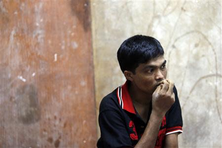 Bozor Mohammed from the Rakhine state in Myanmar listens during an interview at his house in Kuala Lumpur November 8, 2013. REUTERS/Samsul Said