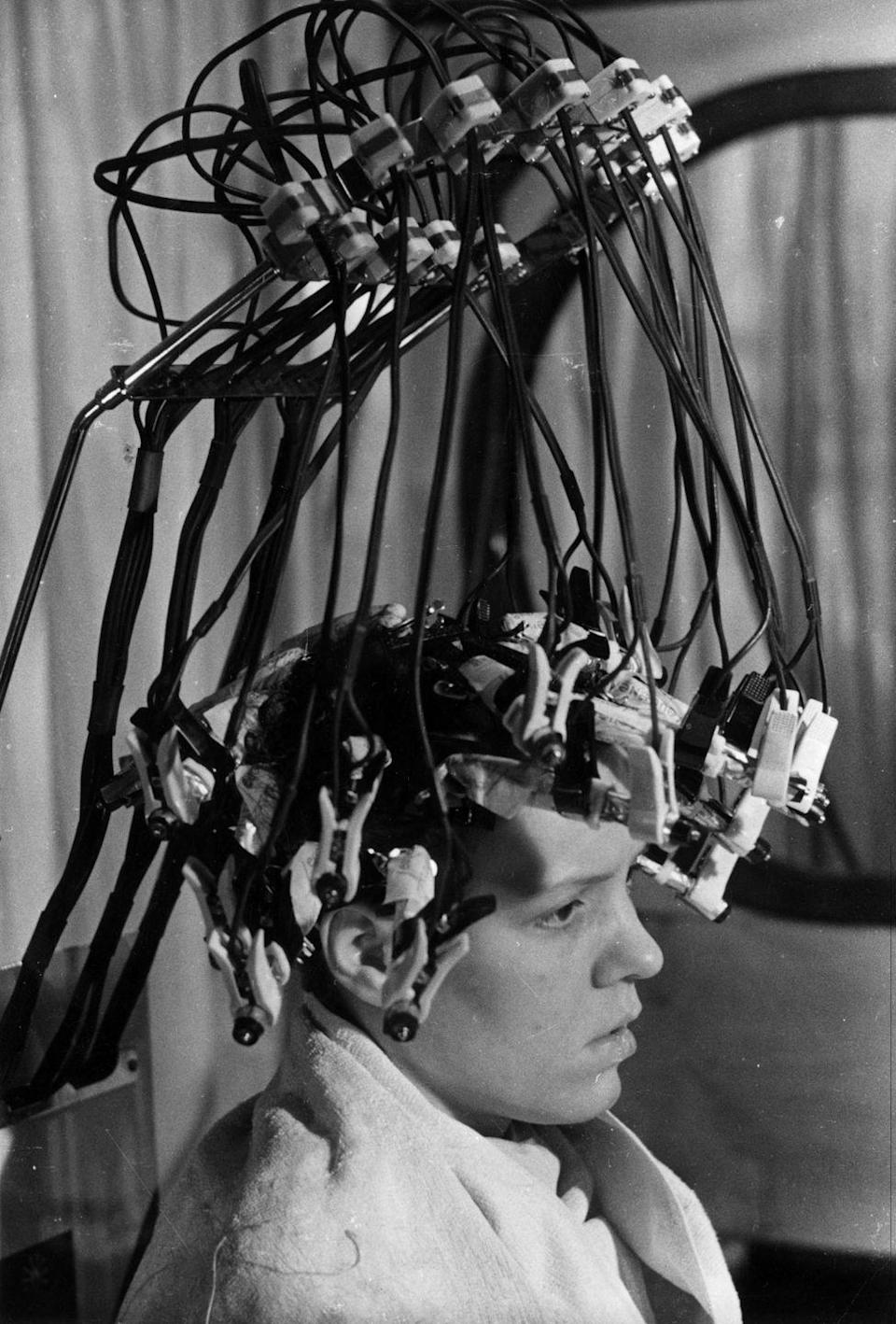 <p>This may look like a contraption straight out of a science fiction movie, but it's actually a permanent wave curler at a London beauty salon in 1939.</p>