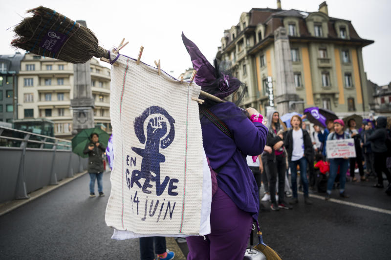 Women's protest during a nationwide strike on Friday, June 14, 2019, in Lausanne, Switzerland. There is list of several reasons motivating people to take part in the strike. These range from unequal wages to pressures on part-time employees, the burden of household work and sexual violence. (/Keystone via AP)