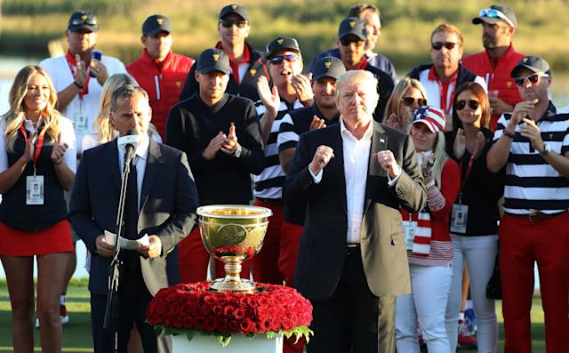President Donald Trump presented the U.S. team with the trophy after they defeated the international team in the Presidents Cup at Liberty National Golf Club.