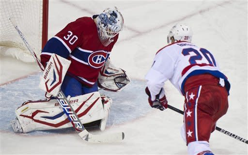 Montreal Canadiens goalie Peter Budaj, left, stops a penalty shot off Washington Capitals' Troy Brouwer during second period NHL hockey action, Saturday, Feb. 4, 2012 in Montreal. (AP Photo/The Canadian Press, Paul Chiasson)