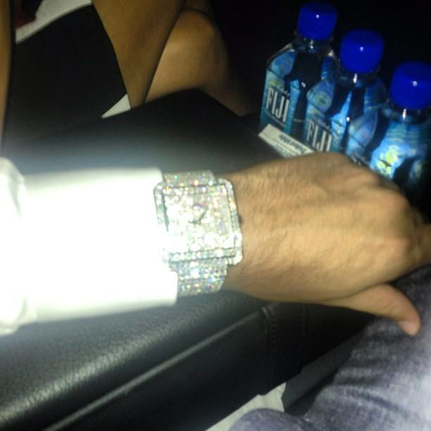 "Would any Kardashian party be complete without a little bling? Scott Disick rolled up to the teen-tastic bash with this flashy, diamond-encrusted watch and captioned his photo, ""On lord time."" Oh, Scott."