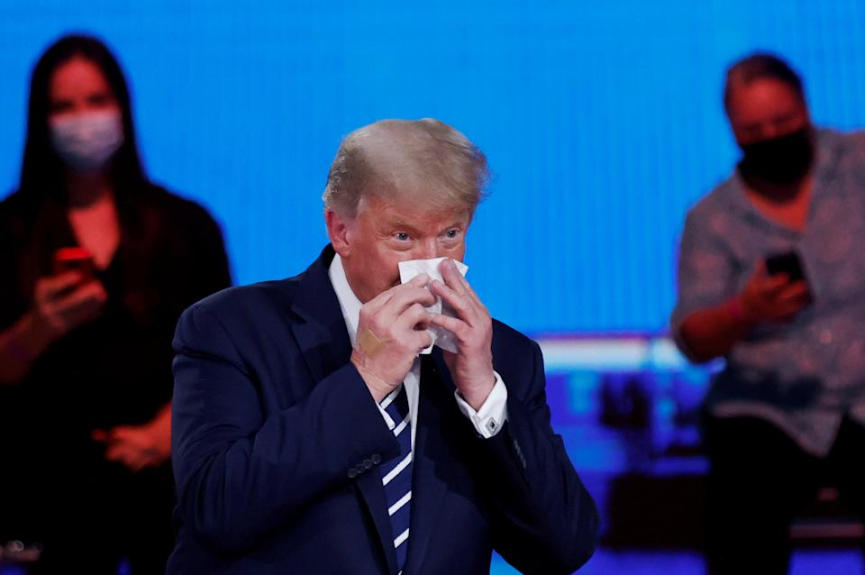 President Trump wipes his nose part during an NBC News town hall in Miami Thursday. (Carlos Barria/Reuters)