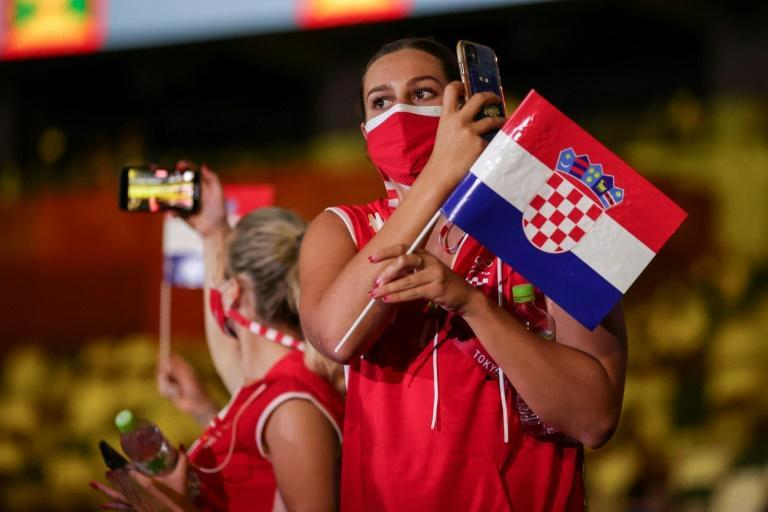Athletes entered the stadiums wearing masks in delegations that were much smaller than usual