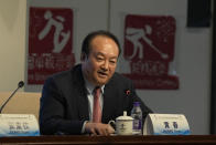 Huang Chun, Beijing's Winter Olympic Games organizing committee official involved with pandemic controls, speaks during a press conference in Beijing Monday, Oct. 4, 2021. When the International Olympic Committee awarded Beijing the 2008 Summer Olympics, it promised the Games could improve human rights and civil liberties in China. (AP Photo/Ng Han Guan)