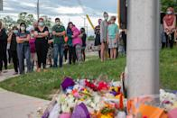 <p>People attend a memorial at the location where a family of five was hit by a driver, in London, Ont., Monday, June 7, 2021. Four of the members of the family died and one is in critical condition. A 20 year old male has been charged with four counts of first degree murder and count of attempted murder in connection with the crime. THE CANADIAN PRESS/Brett Gundlock</p>
