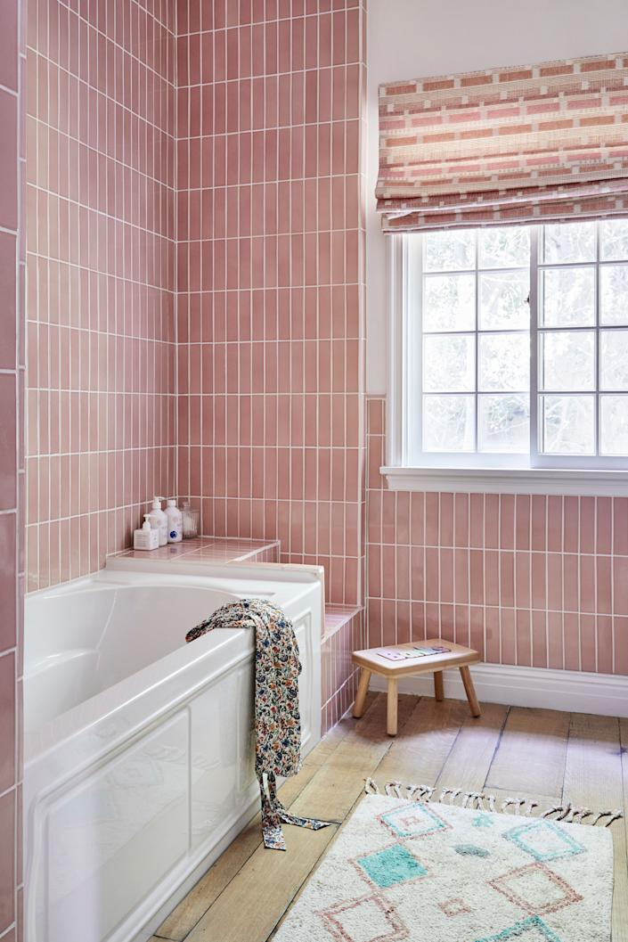 """<div class=""""caption""""> Banks's bathroom is awash in rose-colored subway tiles, hung <em>vertically</em>. """"I am a real lover of Pinterest, and I really liked images I had seen with tiles going that way,"""" says Duff. """"And while the color is so sweet, she could still definitely grow into that bathroom in the coming years."""" </div>"""